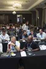 Delegates looking under their chairs for their FREE bitcoin voucher from VALR.com